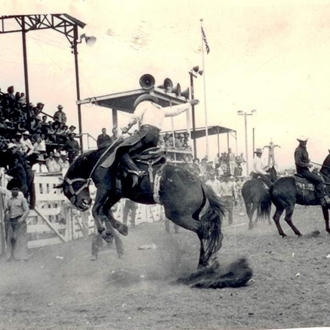old photo of saddle bronc riding
